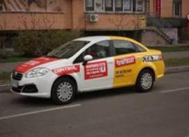 Брендированные такси напоминают о безопасности за рулем
